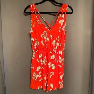 Red Romper with Black and Off-White Floral Pattern